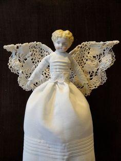 Antique re-dressed angel doll.
