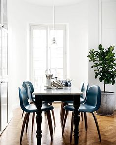 """This """"casual"""" dining spot in front of the kitchen has all the elegance of a grand dame. A second-hand table was upcycled with a marble top and @gubiofficial chairs are sleek in both colour and form. Check out our December issue for more on the beautiful apartment of @hm_home's head of design, Evelina Kravaev Söderberg, or take a tour on our website (insideout.com.au)."""