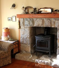 Stone Wall With Woodstove And Bluestone Mantel And Hearth