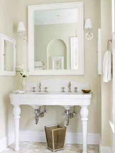 Traditional with a twist, this bathroom pairs a period-appropriate desk base with a custom countertop and backsplash. The elegant DIY vanity easily mingles with furnishings of both now and then, fine and found.