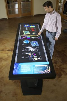 "100"" LED LCD multitouch table with 40+ touch points."