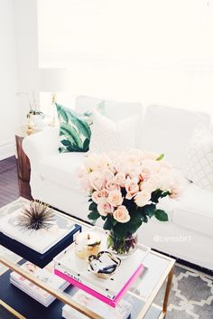 Coffee table styling, gold coffee table, ikea hack, Palm pillows, gold and white pillows, Tom ford, coffee table books, roses