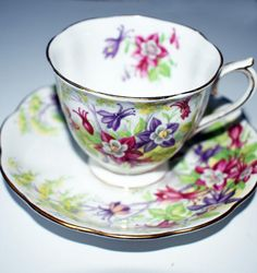 Vintage tea cup and saucer, decorated with flowers, and golden rim Beautiful, Royal Albert Columbine is highly collectible. The set is in excellent vintage condition. No chips, cracks or crazing. It appears this lovely set was used for decorative purposes only. Saucer diameter: 5 3/8
