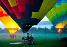 Filling hot air balloons in the early morning