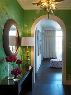 vibrant wall color and modern stylish lighting makes for an intriquing and fun foyer