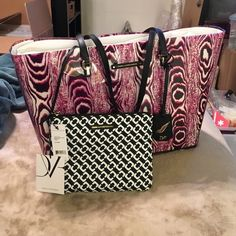 """NWT! DVF clear tote and zippered clutch set! Brand new with tags and original paper! Amazing pink and purple clear tote and black and white zippered clutch set! Gold tone hardware on both pieces. Tote measures 19""""x12""""x6"""" and clutch measures 9""""x7"""". Tote features black leather shoulder straps. MINT!! Beautiful Diane Von Furstenberg! 100% authentic! Diane von Furstenberg Bags Totes"""