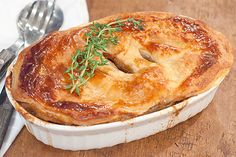 A rich, savory Beef and Stout pie with mushrooms and onions. Wonderfully comforting traditional Irish food.