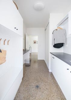These 4 laundry layouts are filled with clever ideas Laundry: Terrazzo floors make the white galley-style laundry pop. A hanging rail above allows for additional storage, and ample cabinetry provides even more space. Utility Room Designs, Modern Laundry Rooms, Laundry Room Shelves, Laundry Room Inspiration, Terrazzo Flooring, Concrete Floors, Hanging Rail, Laundry Room Design, Basement Remodeling