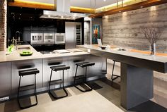 concrete + wood + brick + lacquered cabinets in modern kitchen by Falken Reynolds Interiors
