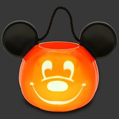 Light-Up Jack O'Lantern Mickey Mouse Trick or Treat Bucket. Have the happiest candy haul ever this Halloween night carrying our glowing Jack O'Lantern Mickey Mouse Trick or Treat Bucket. The frosted features of Mickey's pumpkin face light-up in rotating red, green, and yellow tones. $17