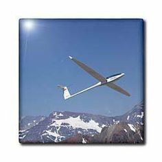 """Airplane in FAI World Sailplane Grand Prix, Chile - SA05 DWA0080 - David Wall - 12 Inch Ceramic Tile by 3dRose. $22.99. Dimensions: 12"""" H x 12"""" W x 1/4"""" D. Image applied to the top surface. Clean with mild detergent. Construction grade. Floor installation not recommended.. High gloss finish. Airplane in FAI World Sailplane Grand Prix, Chile - SA05 DWA0080 - David Wall Tile is great for a backsplash, countertop or as an accent. This commercial quality construction grade tile ..."""