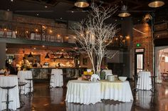 Love Farm and Filigree's tall white trees as a focal point in the center of the room at the Cookery in Durham, NC.