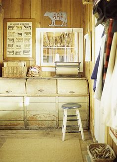 Great way to sort your dirty clothes! Old roll-top feed bins.. refinish them to fit your laundry room style!