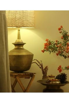 The ikea table, jute lampshade, fern fronds are all fairly contemporary and the brass table lamp are traditional. The bougainvillea flowers at the corner of the living room. | Home Tour: A beautiful Antique Modern home in Bangalore ~ The Keybunch Decor Blog Brass Table Lamps, Brass Lamp, Makes You Beautiful, Beautiful Homes, Brick Cladding, Ikea Table, Vintage Trunks, Indian Homes, Stone Flooring