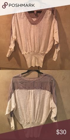 Free People sweater Light material Free People sweater. Worn a couple times - still in fairly good condition. Has a couple pulls on the sleeves Free People Sweaters V-Necks