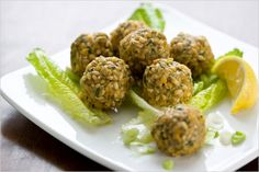 """NYT Cooking: I adapted this from an Armenian recipe that I found on the back of my packet of red lentils. Kufteh (Persian), köfte (Turkish), and kibbeh (Arabic) are round walnut size patties usually made from pounded meat (the word means """"pounded"""") but sometimes made with fish or vegetable pulp, mixed with fine bulgur, herbs, and spices. Serve this vegetarian version as an appetizer or a side dish."""