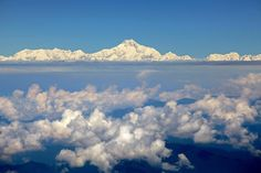 Mt. Everest from window of a Druk aircraft flying from Bankok to Paro. Mt. Everest is highest mountain above sea Lebel at 29,029 feet