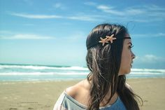 DIY beach babe.  Make headbands/barrettes/hair ties with shells, sand dollars, & sea stars.