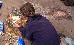 Street artist creating a work of art in Dublin