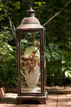 Ana Rosa. A lantern with or without glass is a beautiful clouche.