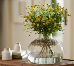Like a necklace or an embroidered collar, metal filigree turns this beautiful vase into a statement piece for your home and gives a unique edge to floral arrangements.