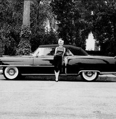arilyn Monroe and her 1954 black Cadillac. Photo by Milton Greene.