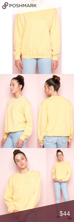 """Brandy Melville Erica Honey Embroidery Sweatshirt Relaxed fit blended cotton pullover sweatshirt in yellow with a crewneck front and gold Honey embroidery on the left chest.  Fabrics: Measurements: 26"""" length, 20"""" bust Brandy Melville Tops Sweatshirts & Hoodies"""