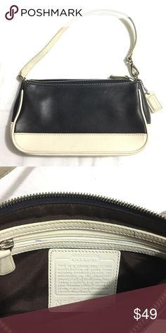 Authentic COACH Navy/White small leather bag Gentle wear and tear; overall good condition. Has a couple of pen marks as shown in photo. Make me an offer or bundle 3+ items for a 15% discount, only pay shipping ONCE, and get a FREE gift! Coach Bags
