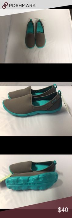 Crocs shoes Crocs soft, everyday shoe, comfortable. Colors are dark gray and turquoise CROCS Shoes Flats & Loafers