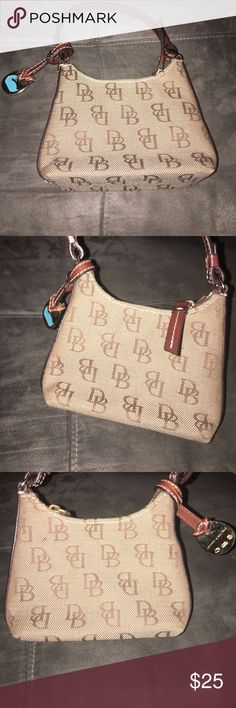 Dooney and Bourke mini purse Dooney and Bourke mini purse great condition Dooney & Bourke Bags