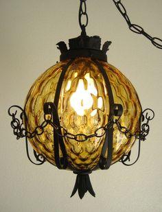 Vintage Gothic Optic Glass Swag Lamp, Retro Spanish Hanging Wrought Iron Light. $179.00, via Etsy.