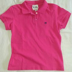 "Lilly Pulitzer Magenta Polo Shirt (M) This gently used Lilly Pulitzer polo shirt is a great color! Magenta is most accurate in pic 4. Matches almost every LP skirt I've owned. Cotton/spandex; machine wash warm, tumble dry low. Measures approx. 18"" from armpit-to-armpit & 20"" from base of collar to back hem; 1"" side vents. Extra LP button still sewn inside. Shows minor fading along edges, but no noticeable damage or stains. Comes from smoke-free home. Lilly Pulitzer Tops Tees - Short Sleeve"