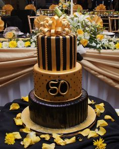 Black and Gold 50th birthday with gumpaste bow topper