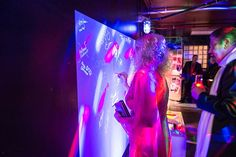 <p> Guests signed a light graffiti wall at the Comcast Spotlight holiday party in November 2014. JDK Group produced the...