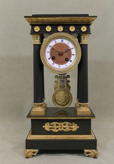 French Portico Clock, early 19th century, gilt and patinized bronze