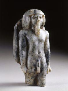 Gneiss statuette of a Male Deity Old Kingdom 3rd Dynasty, c.a. 2675-2625 B.C. 21.3x9.2 cms.