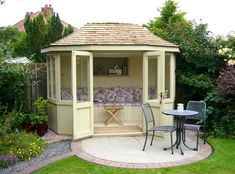 Oval shaped Sun Ray summerhouse, painted with seating/upholstery from our Scotts range