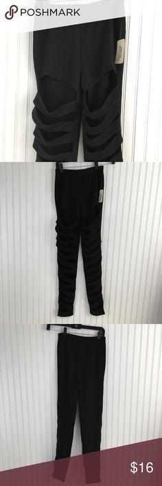 "New Forever 21 black  stretchy cutout legging NWT Forever 21 Black stretchy cutout leggings. Front with cutout sections. Solid back. Pull out elastic waistband. inseam: 27"" Forever 21 Pants Leggings"