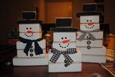 2x4 snowmen  I got this idea from Under my Umbrella, go check out her site.  So cute and so simple to make.  To make a set of three you will need:  3: 3 inch 2x4's  3: 4 1/2 inch flatboard  6: 3 1/2 inch 2x4's  6: 5 inch 2x4's  3: 6 1/2 inch 2x4's  white paint  black paint  scrap fabric  buttons  orange paper  glue gun  I just love my snowman set! So fun for winter/christmas decor.