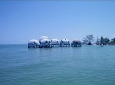 ✖ The Mysterious Dome Homes marching into the Sea, Marco Island in Cape Romano, Florida.