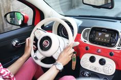 The new Fiat 500 Convertible Coral Interior, Steeling wheel and circular design.