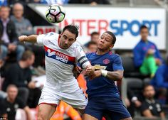 Latics captain and defender Morgan tussles for possession alongside United's Holland international winger Depay at the DW Stadium