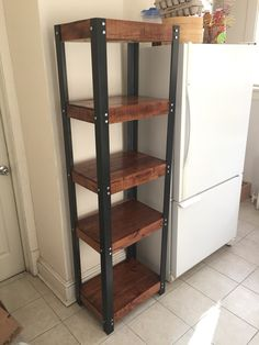 """Pantry shelves built out of reclaimed pallet wood. 2"""" steel angles hold the shelves. Custom stain. Clear gloss finish."""
