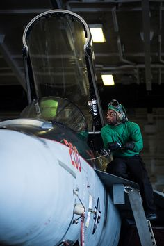 PACIFIC OCEAN (Nov. 7, 2012) – Aviation Structural Mechanic (Equipment) 3rd Class Daryll Williams, assigned to the Black Knights of Strike Fighter Squadron (VFA) 154 opens the canopy of an F/A-18E Super Hornet in the hanger bay of the aircraft carrier USS Nimitz (CVN 68). Nimitz is currently underway participating in the ship's Joint Task Force Exercise (JTFEX