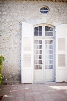 arched french doors w/ full length shutters, love this look