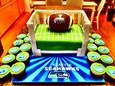 Seattle Seahawks Super Bowl and Baby Shower Cake.  This cake is a fusion of two themes, Super Bowl and Baby Shower, so I put the football in a crib with the football field as mattress.