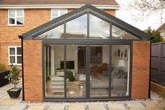 Bi-fold doors in Hampshire add a contemporary feel to orangeries and conservatories. View our aluminium Bi-Fold Door range and get a FREE quote. Bungalow Extensions, Garden Room Extensions, House Extensions, Orangerie Extension, Conservatory Extension, Orangery Extension Kitchen, House Extension Plans, House Extension Design, Extension Ideas