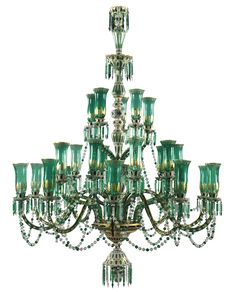 A pair of green glass chandeliers for the Indian market, Bohemia, 20th century, comprised of two tiers of lights, the upper corona with five cups on tubular facet-cut stems, the lower wider tier with twenty cups staggered at two levels, all with gilt detail in the Mughal style,247cm.height; 175cm. wide; 8ft. 1¼in., 5ft. 8¾in. Estimate      48,636 - 72,954USD