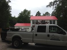 http://www.harborroofingandsiding.com/services/metal-roofing - A beautiful red metal roof done by Harbor Roofing and Siding of Wilmington, NC.