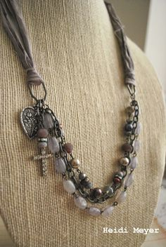 Love this look with fabric and multi strands...perhaps use leather straps with it instead of fabric.